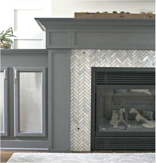 herringbone fireplace tile surround